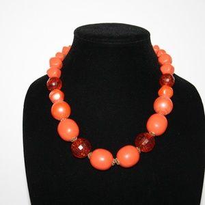 Large vintage chunky orange necklace.